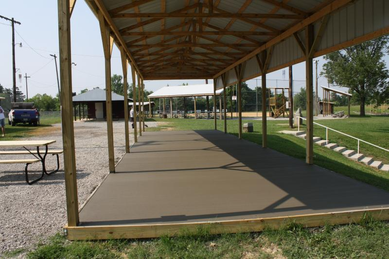 Recently constructed pavilion with newly poured concrete pad