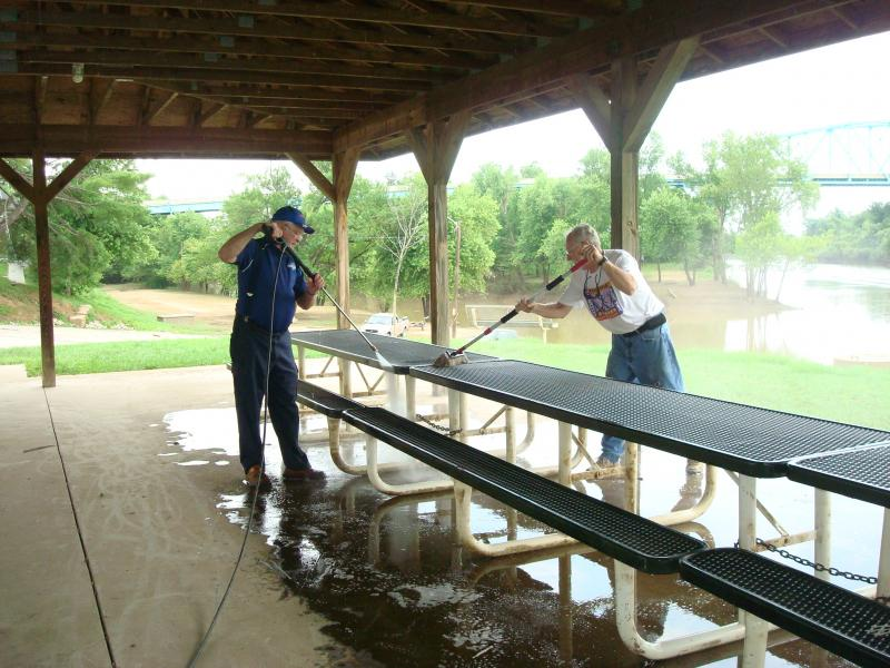 Ralph Wetzel and Sonny Renfrow pressure washing & scrubbing the picnic tables