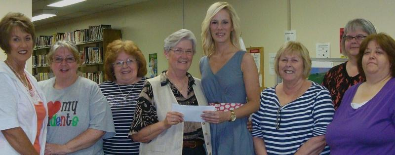 Check presentation by Livermore Woman's Club to the MDA