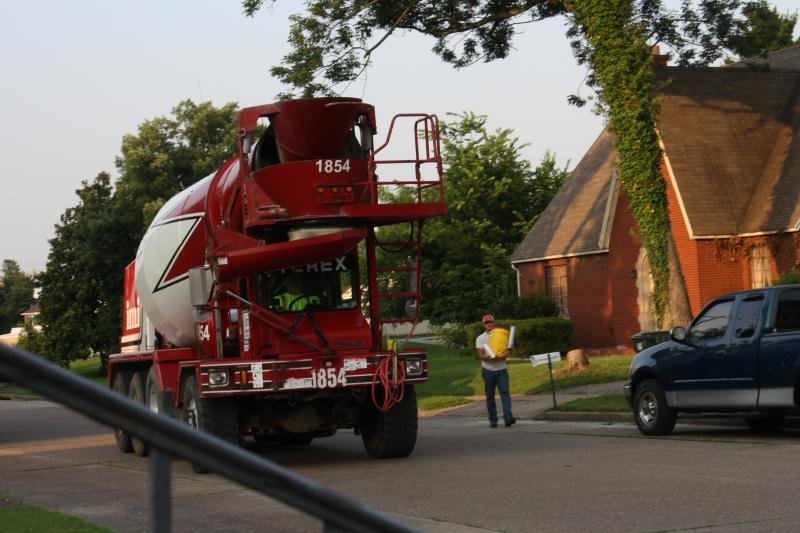 6:45 a.m., the concrete truck arrives and so too does the water!